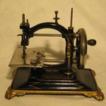 A minature sewing machine from the collection