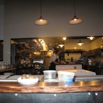 View into the kitchen from the kitchen bar seating