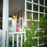 Roses and grape vines grow on the southeast side of the front porch.
