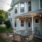 The side patio is lit for summer evenings and is available for breakfast service on request.