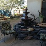 A little sitting area and fountain in our garden that now has a fireplace in the center
