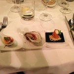 The Amuse-bouches trilogy: oyster, homemade smoked salmon, scallop