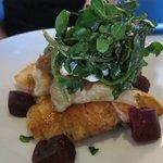 Roasted Tasmania Salmon with potato pierogi, pickled beets and sour cream