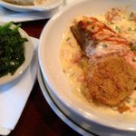 Sautéed spinach, seared salmon on cheesy grits and a lobster butter sauce along with fried green