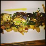 Charred octopus with creamer potatoes, spring onion, capers, pancetta
