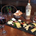 Cheese plate with bread basket and wine