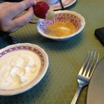 dipping strawberries in sour cream and then sugar, yum!