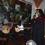 Fado singer with band