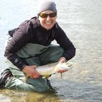Happy client with her first brown trout caught fly fishing