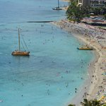 The view from our lanai of busy Waikiki beach