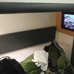 Bed and mounted tv at foot of bed