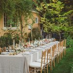 Table set for al fresco wedding dinner