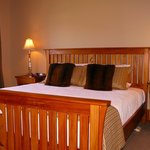 Holly Homestead deluxe suite handcrafted rimu timber bed