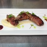 Quail Drumsticks rolled in Prosciutto with Lingonberry, Parsnip Purée, Veal Demi, Herb Oil, Micr