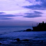 Tanah Lot temple in the distance very early in the morning