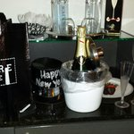 Champagne, chocolate dipped strawberries and New Years dag recovery package. Top shelf all the w