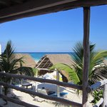 another view from the porch, with sun shade shelters on the beach