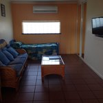 Unit 3, very cool and clean. Living area with wardrobe for extra storage, single bed with roll a