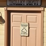 Funny sign on the door where you purchase trolley tickets