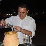 Albert Serving up a shot of Ecuadorian Liquor