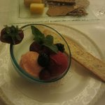 A sorbet with a hazelnut biscoti and a cheese plate dessert