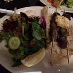 Lamb souvlaki with salad
