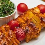 Shish Taouk ( char-grilled chicken) cubes with cherry tomatoes