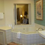 Jacuzzi with shutters open to bedroom