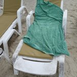 Old sunbed and towel