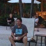 Art enjoying his evening drink on the beach.