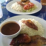 Honey pork chop with rice & beans, chicken dish