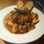 Arturo's gnocchi, tomato broth, cremini mushrooms, roasted garlic and pork shoulder