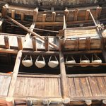 Wooden beams and poles of the rammed earthen buildings