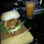 Fish burger with carrot and orange juice