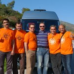 Our Group with the Driver Kostas and the Mini Bus behind
