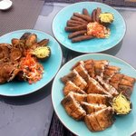 Off-the-menu breakfast feast: Filipino sausages, fried bangus (milkfish), another fried fish