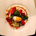 Warm salad of chorizo and poached duck egg
