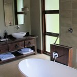 Bathroom- to sinks, nice bath tub but you can't sit in it...