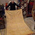 Mohammad Showing a cactus silk rug