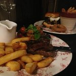 Rump steak (£10.99) with tarragon hollandaise (£1.19) sauce and gourmet stacked burger (£9.99) E