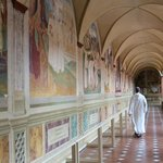 A monk walking in the Great Cloister