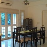 Dining area also includes refrigerator for guests