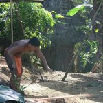 Embera villager chops wood in typical attire