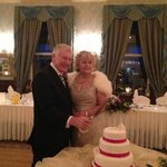 Jim and Isobel cutting the cake