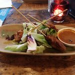 Chicken satay skewers with light fresh cucumber salad and rich peanut sauce.