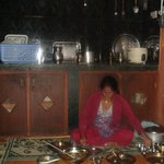Sumitra (Damodar's wife) in the kitchen where dinner is served