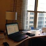 Desktop and window facing Palomar hotel.