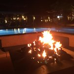 Night time view of the Pool Firepit