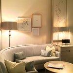 Circular corner sofa and artwork