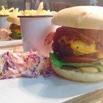 The GPT Dirty Burger topped with American cheese, smoked bacon and 16 hour smoked pulled pork x
